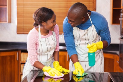 47588290 - lovely young black couple cleaning together in their kitchen
